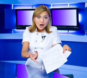 7465009 - a television anchorwoman at a studio is shocked by news she has in her hands