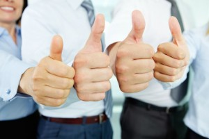 15751391 - close-up of business team holding their thumbs up